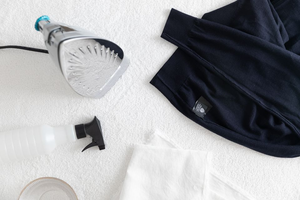 preparing to iron a wool sweater