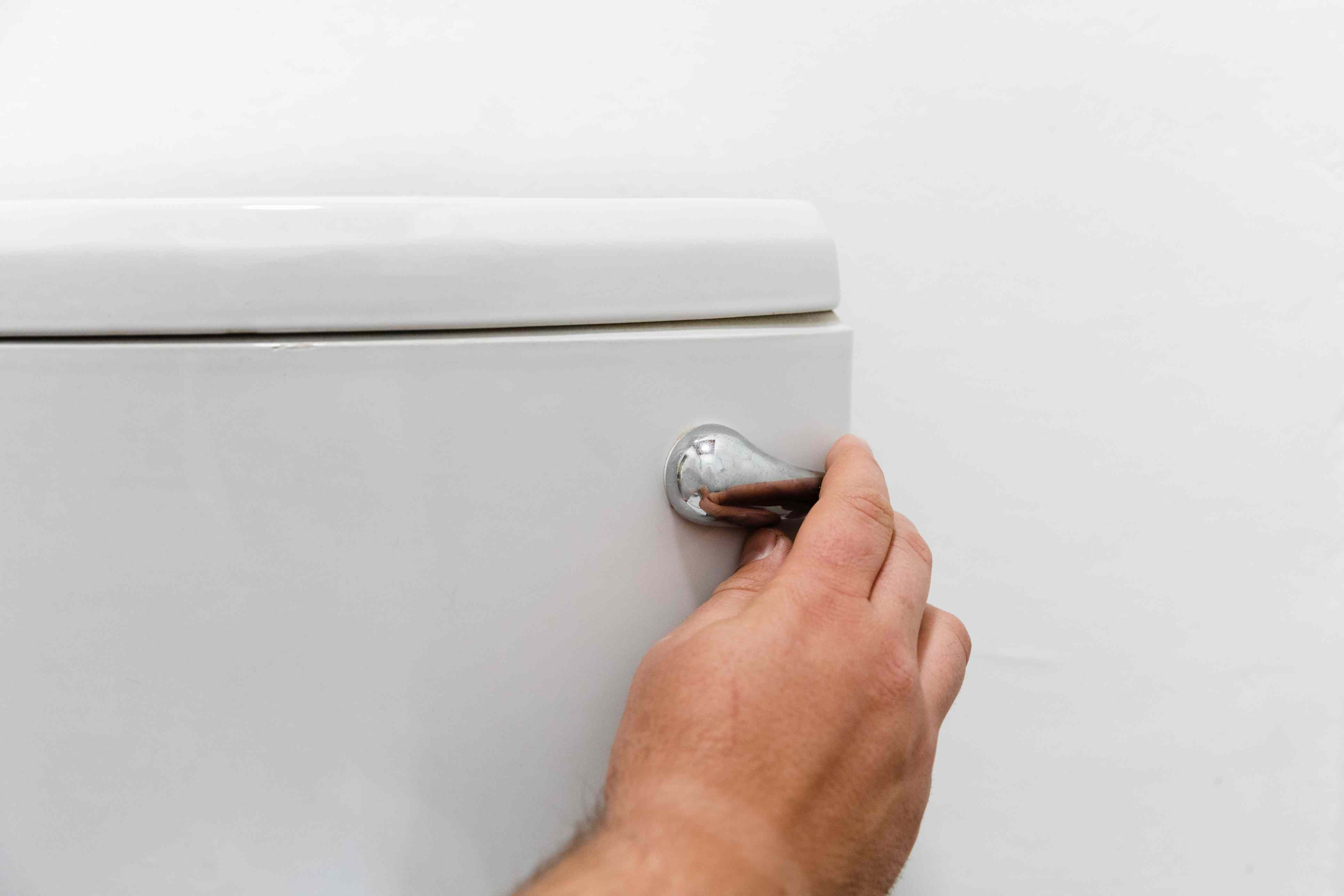 jiggling a loose toilet handle