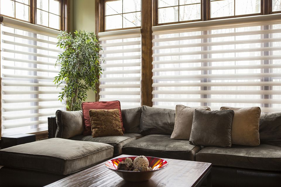 Sofa and blinds in a living room.