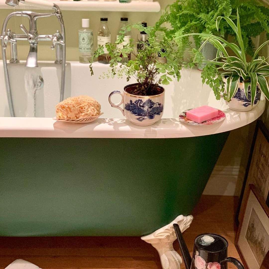 Bathroom with green clawfoot tub