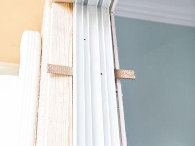 Wood shims on a window frame