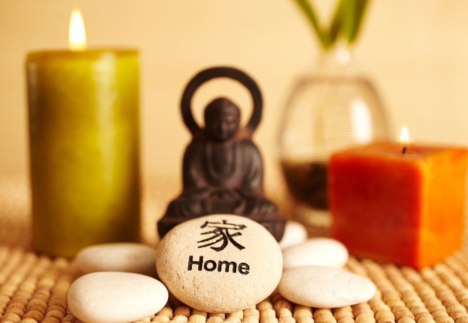 candles, buddha and stones for good feng shui