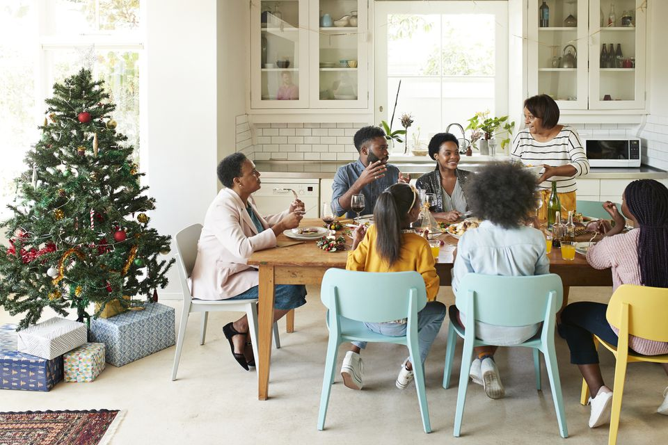 Family and friends talking while enjoying meal
