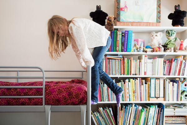 girl climbing bunk bed