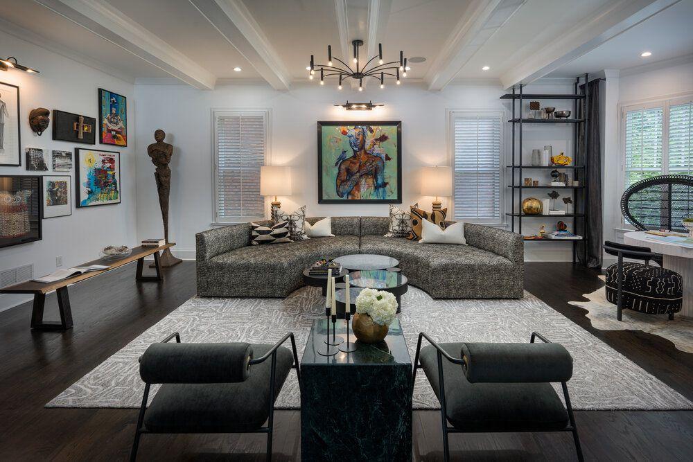 studio light accenting artwork in living room