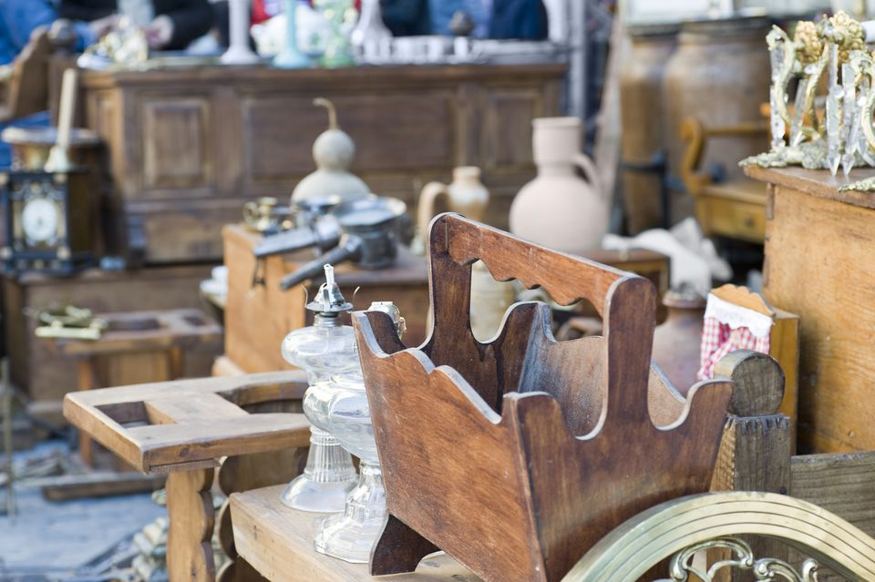 Old and antique furnishings at yard sale