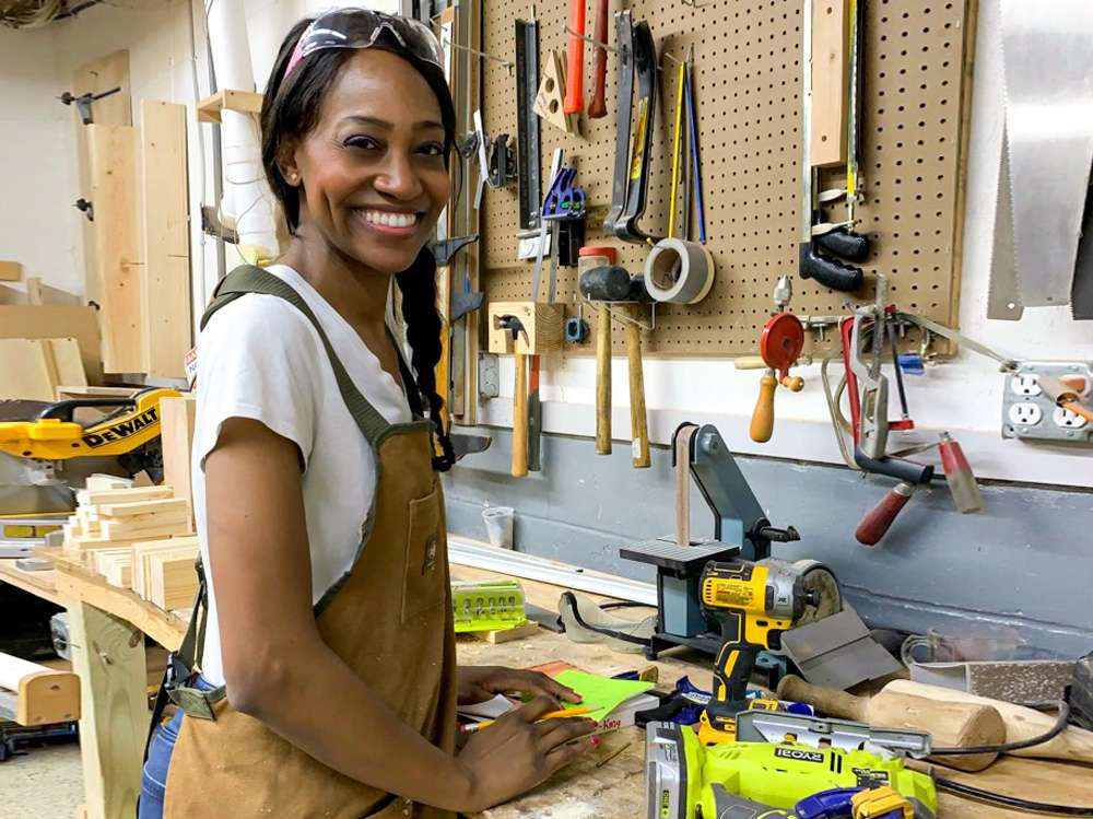 Char Miller-King poses in her workshop for Girls Who Build