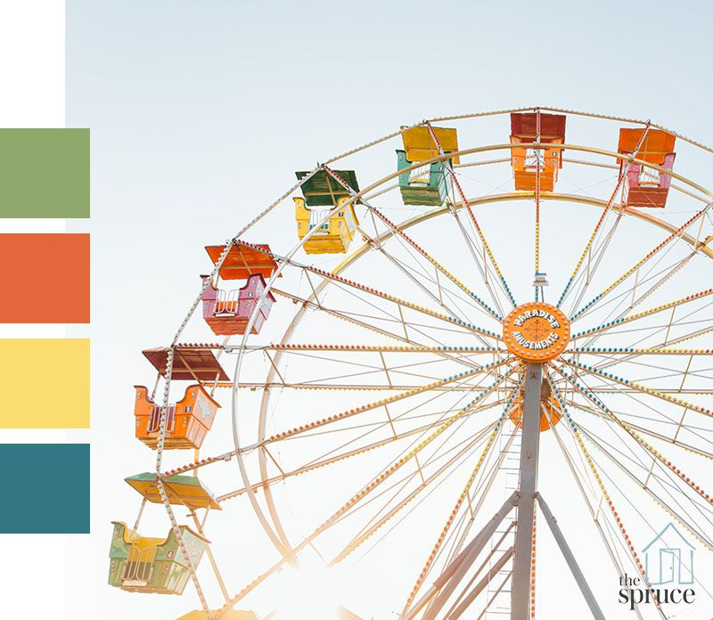 A colorful ferris wheel with four paint color swatches to the left of the image