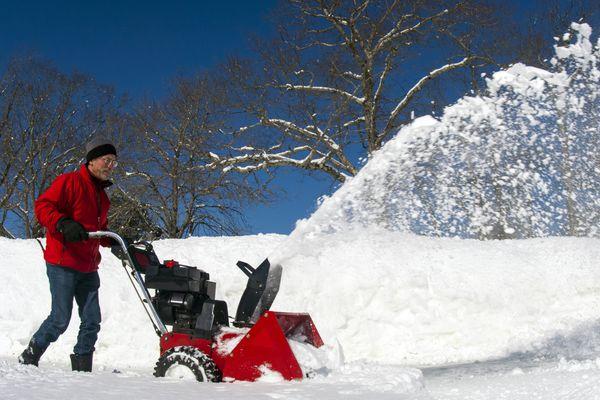 Man using gas snowblower in Damariscotta, Maine.