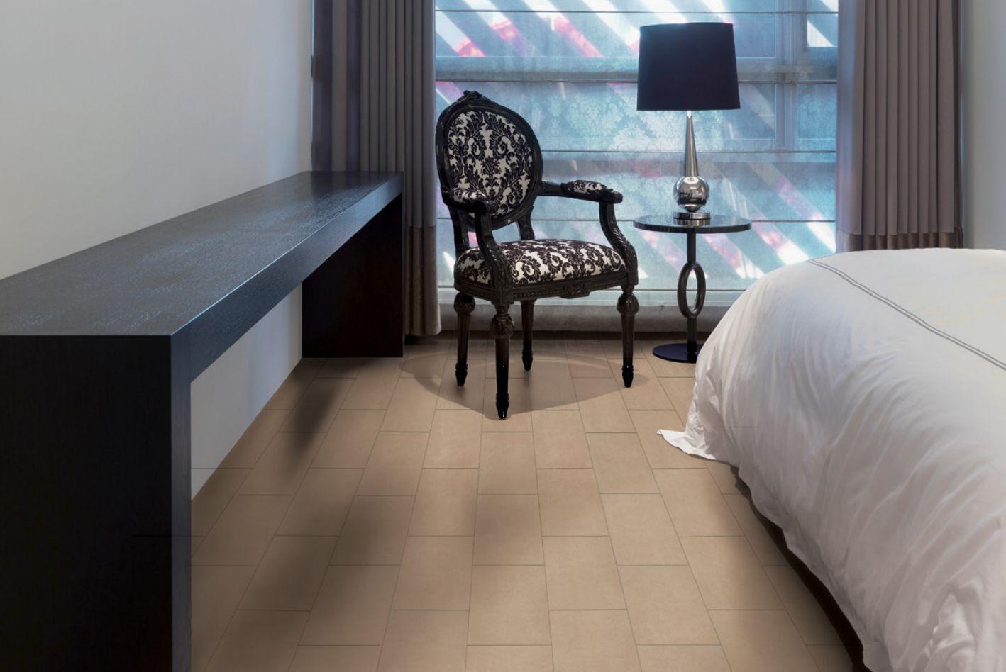12 x 24 Infinite Brown Tile In a Bedroom