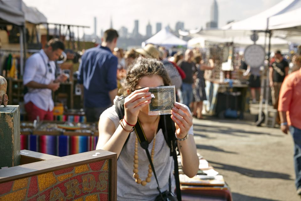 shoppers at Brooklyn Flea, Williamsburg. Brooklyn, New York.