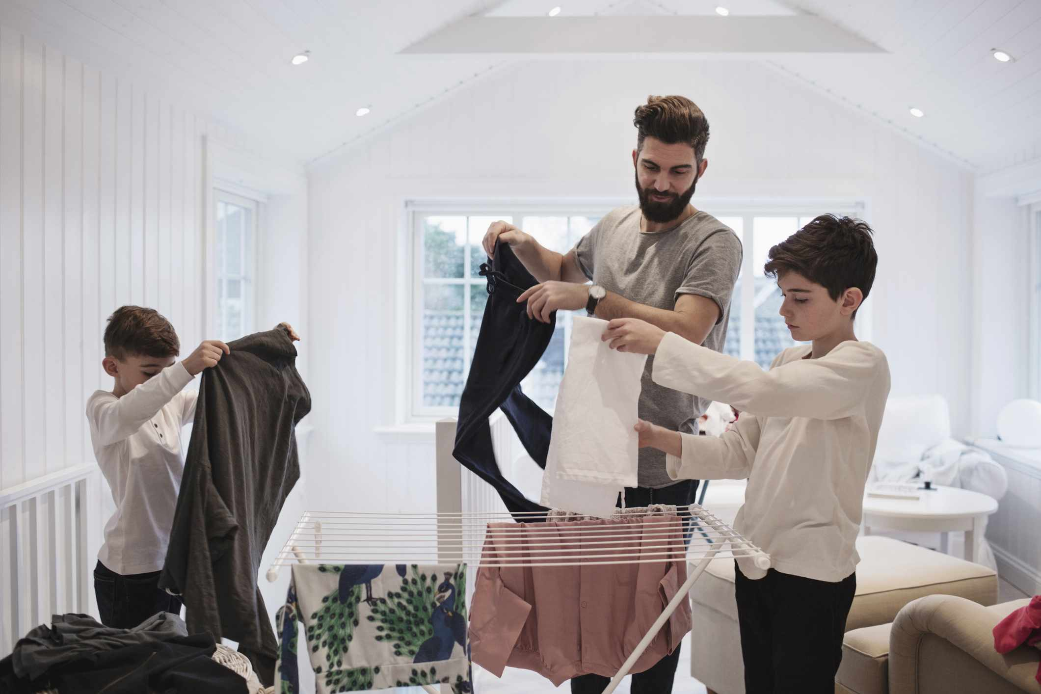 Father and sons doing laundry