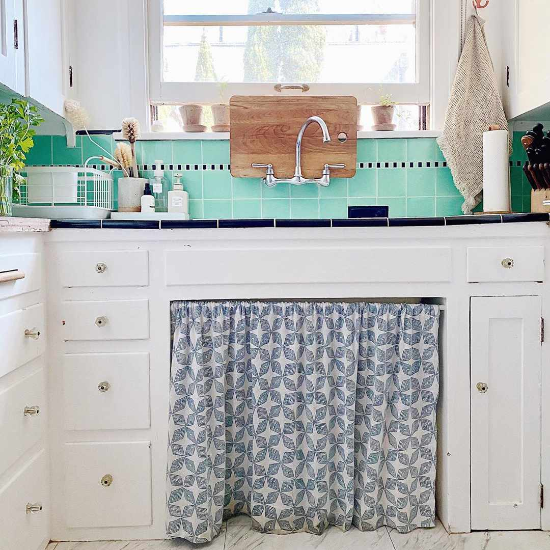 Kitchen sing with a curtain under it