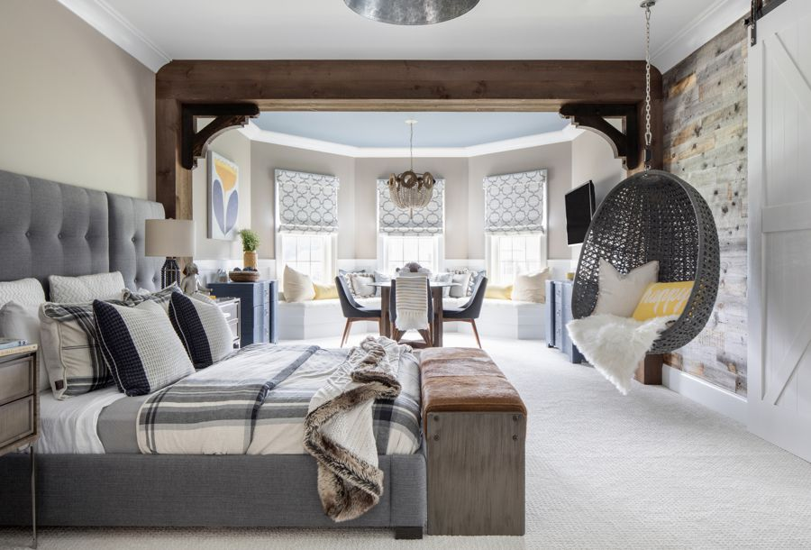 a bedroom features cozy pillows and throws for autumn
