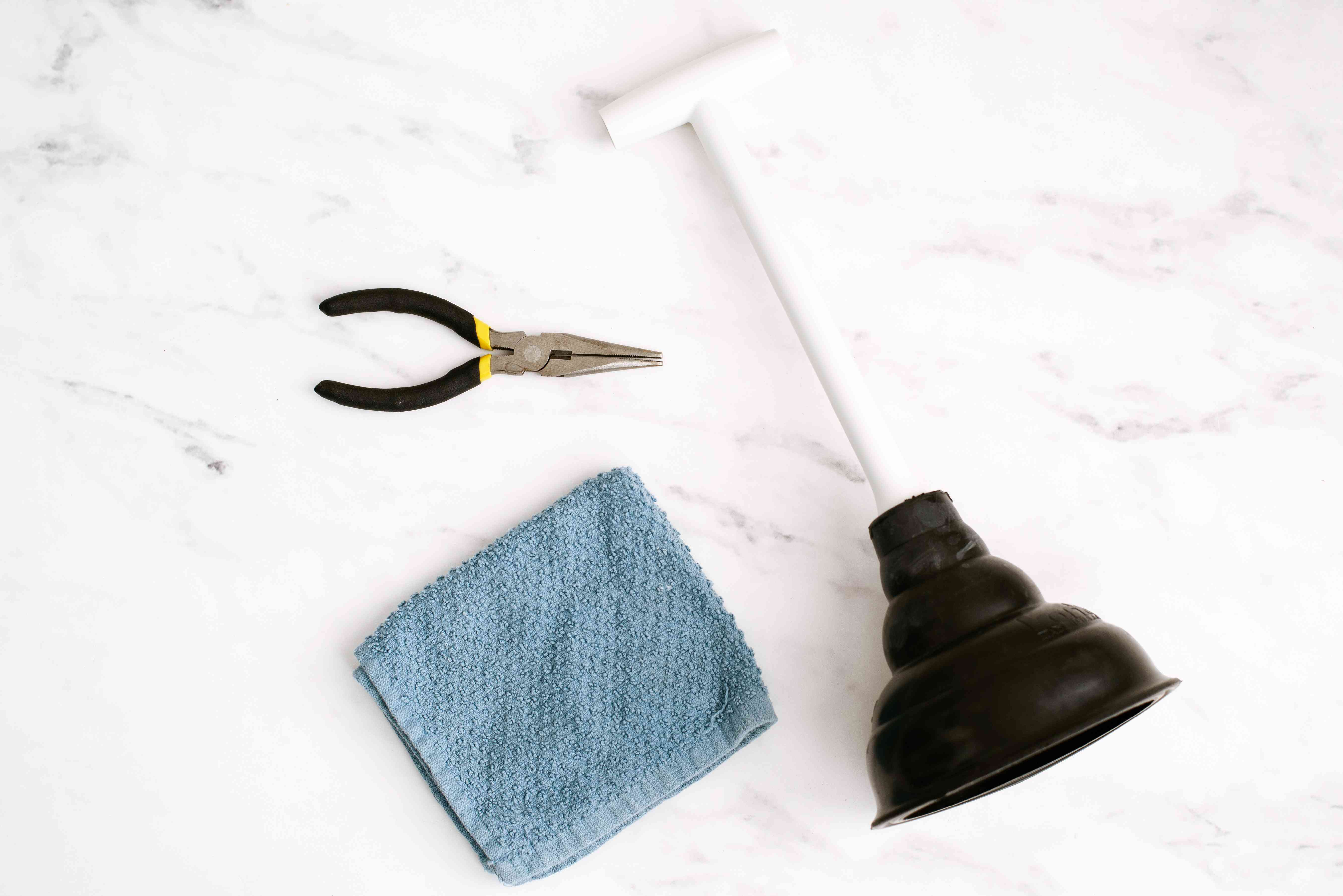 Materials and tools to unclog a sink drain
