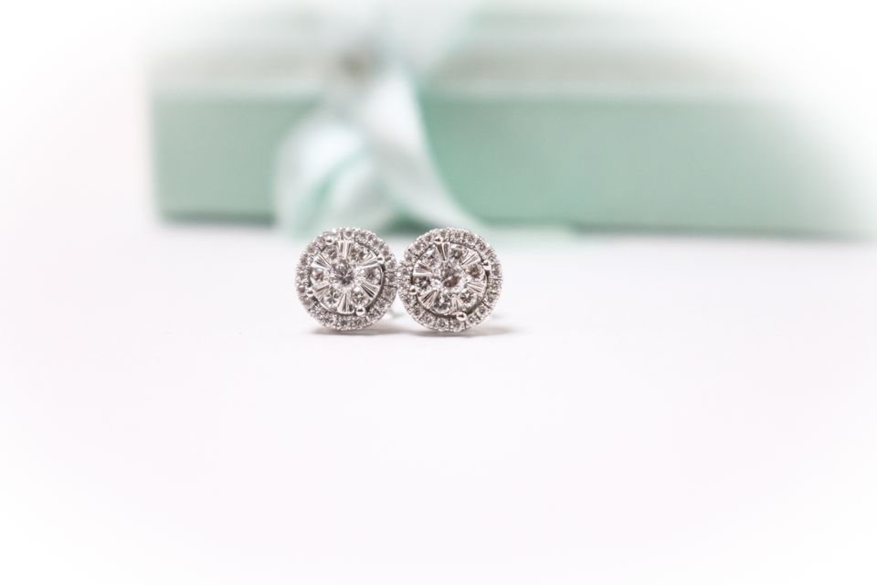 silver earrings in front of a gift box