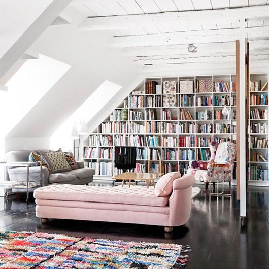 Colorful home library with pink chaise lounge