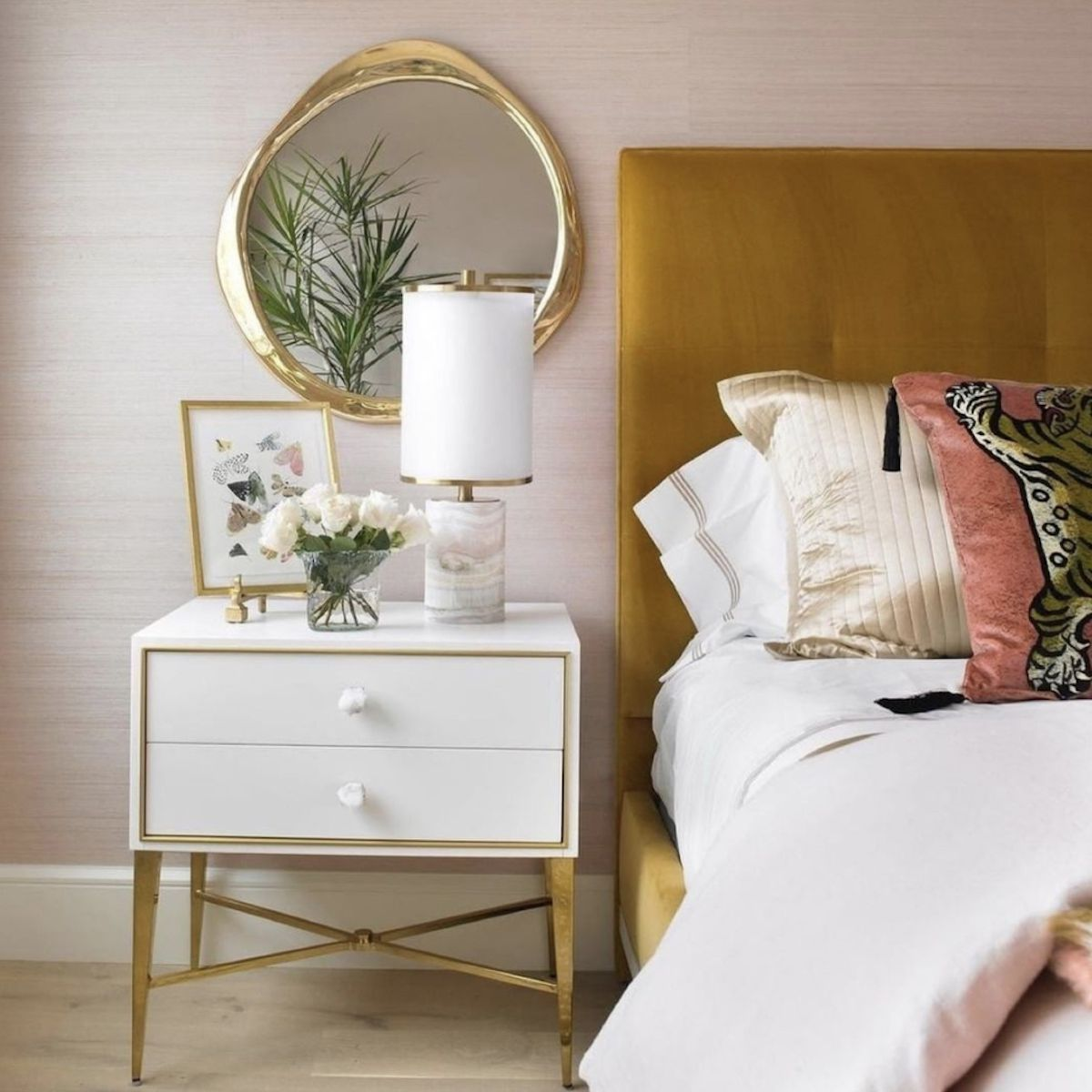 neutral bedroom with golden accents