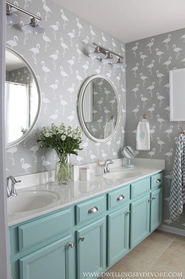 Gray and aqua kids' bathroom with flamingo motif