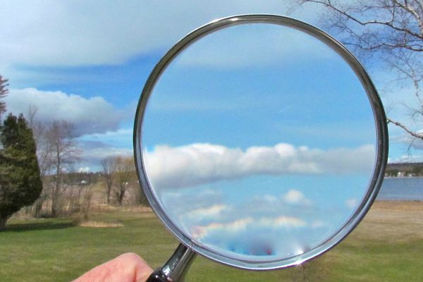 Magnifying Glass raised to the sky