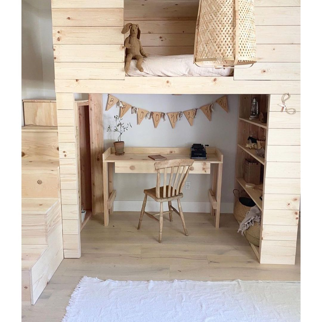 A DIY kid's loft bed with a homework station below and a bed on top.