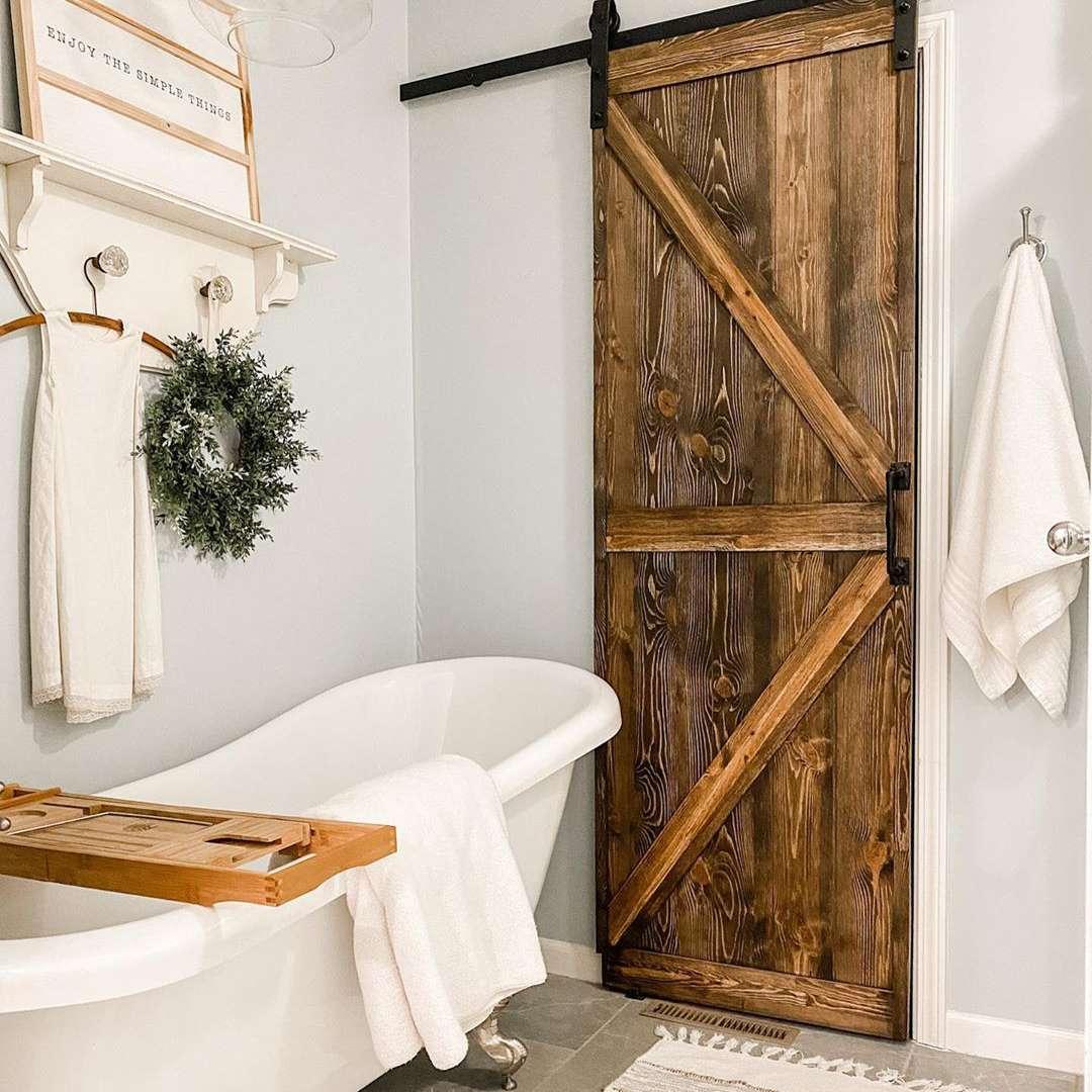 Farmhouse inspired barn door in bathroom