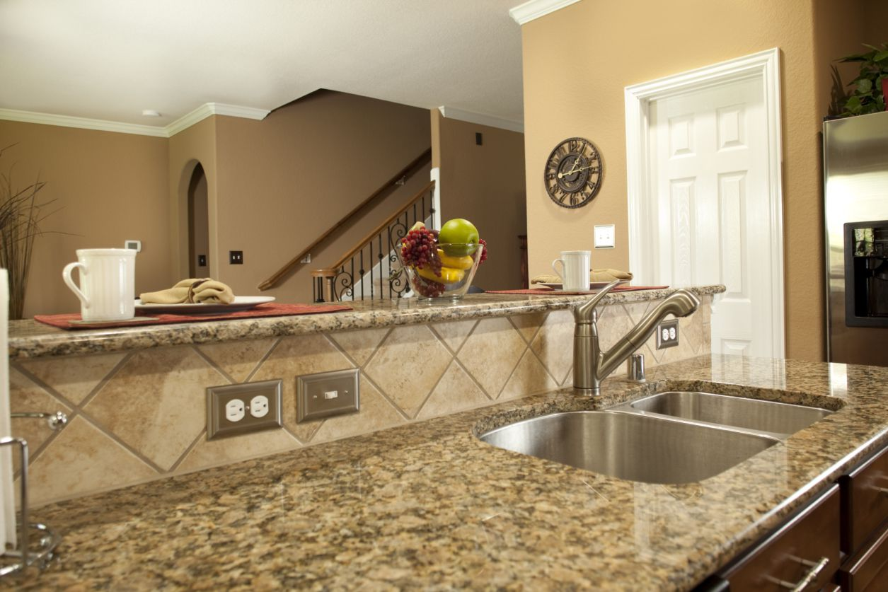 Pre-fabricated granite with a bullnose edge in a beige-style kitchen