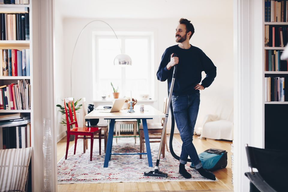 man standing with vacuum