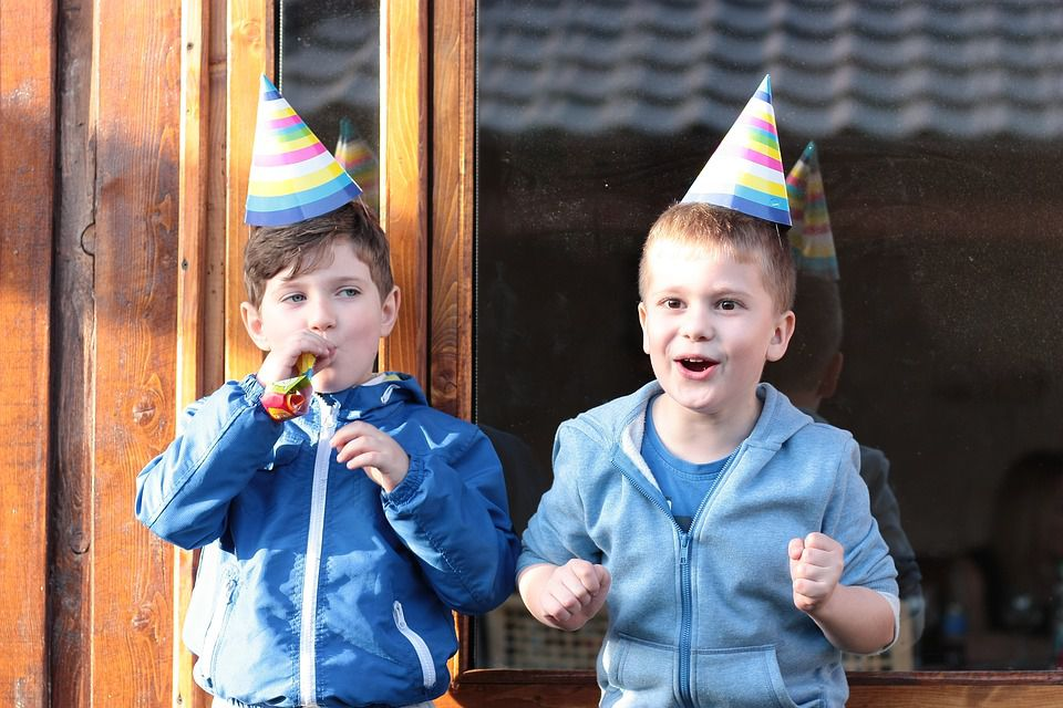 Happy kids at a birthday party.
