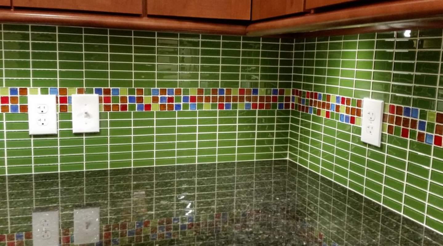 Green brickwork tile backsplash in a kitchen
