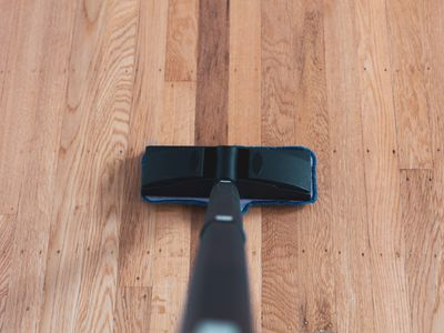 steam cleaning a hardwood floor
