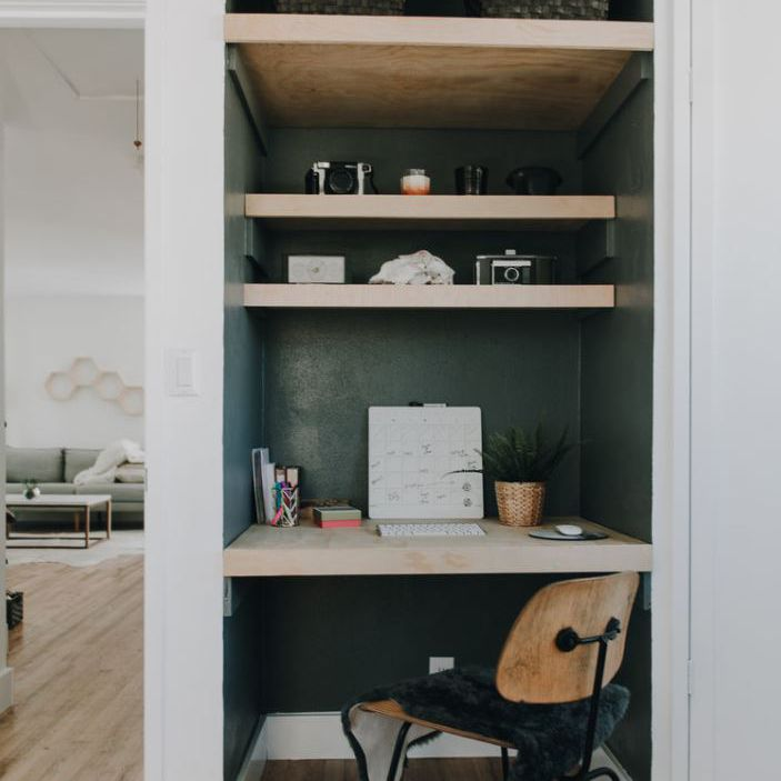 Nook office built into wall with dark green paint