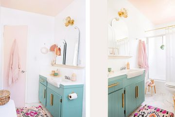 completely renovated bathroom with pink door, teal cabinetry, new tile