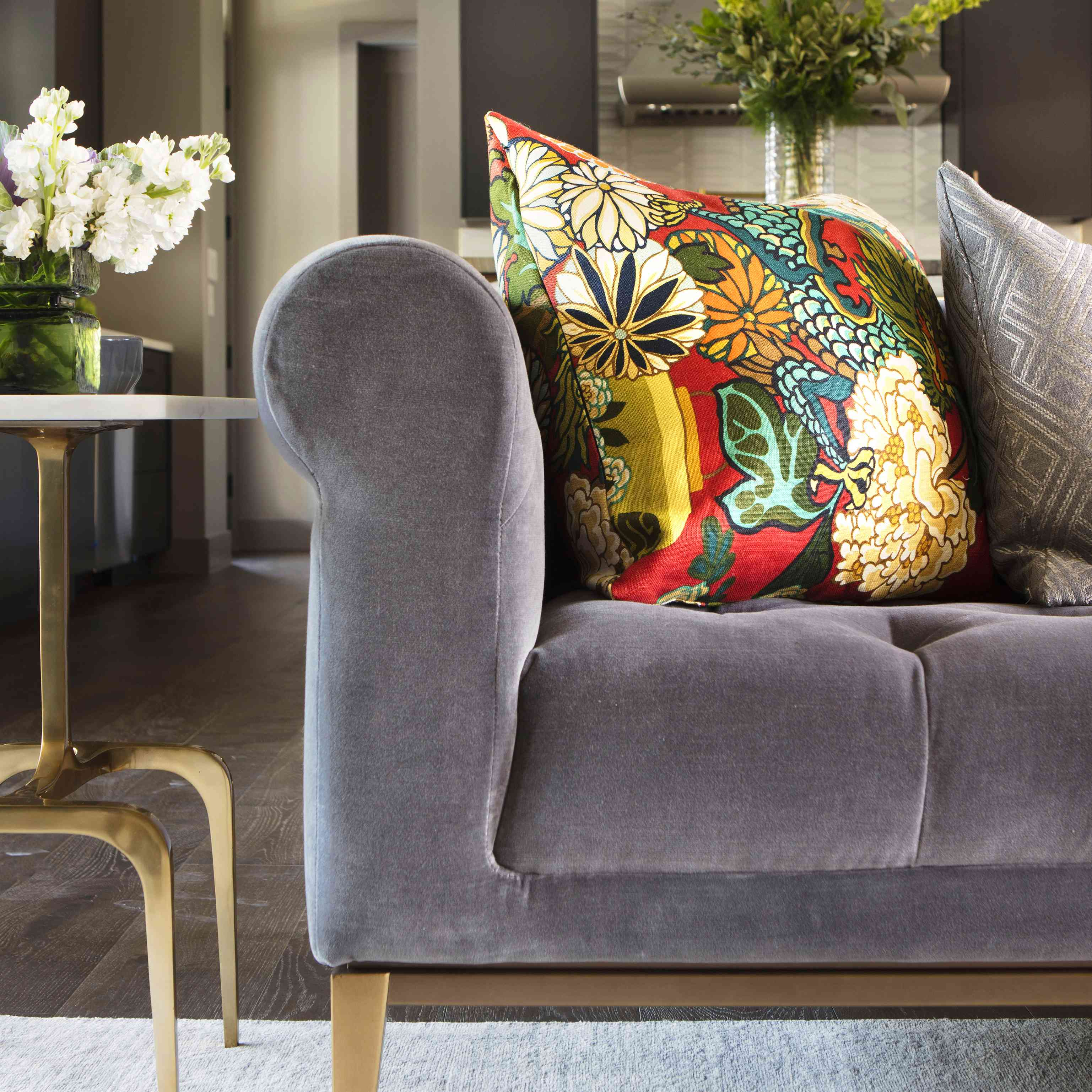 a living room with a color throw pillow