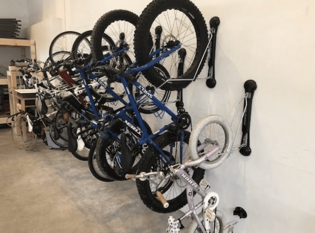 bikes hanging on racks mounted to garage wall