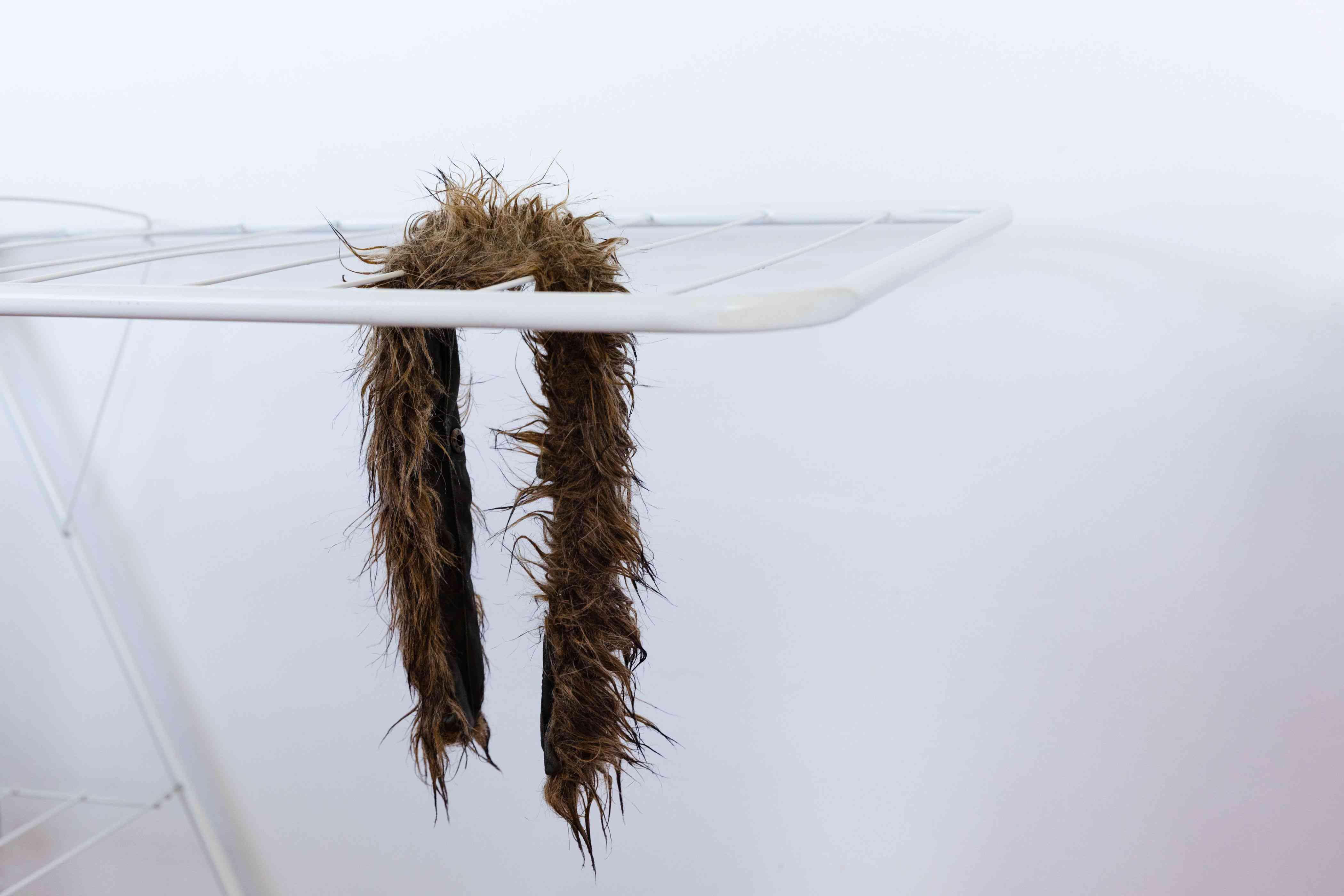 Letting the faux fur trim drip dry