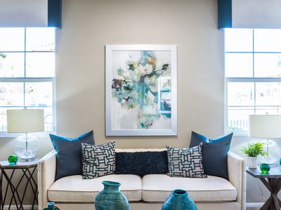 white and blue living room with two windows