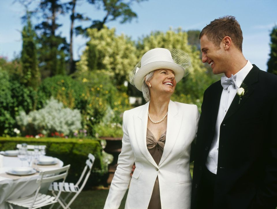 mother of the groom and the groom at an outdoor wedding