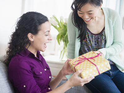 Woman giving friend present