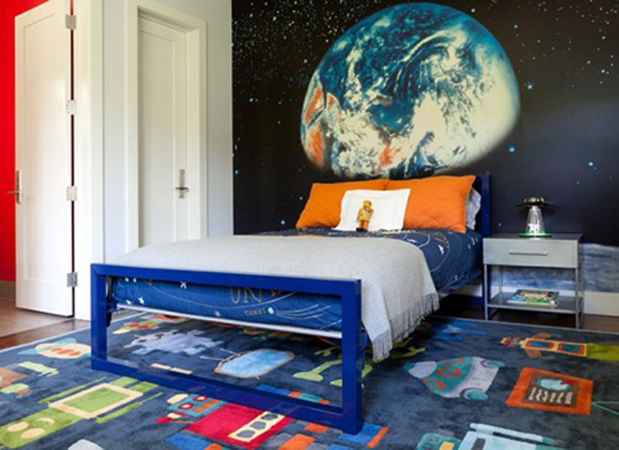 Space-themed kid's room with robots and earth mural