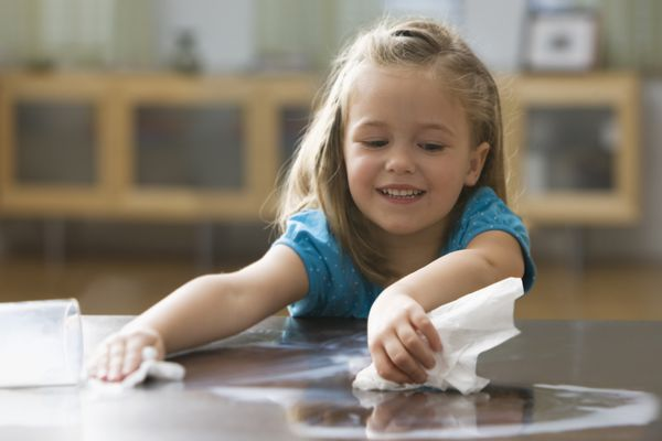 Young girl using paper towel