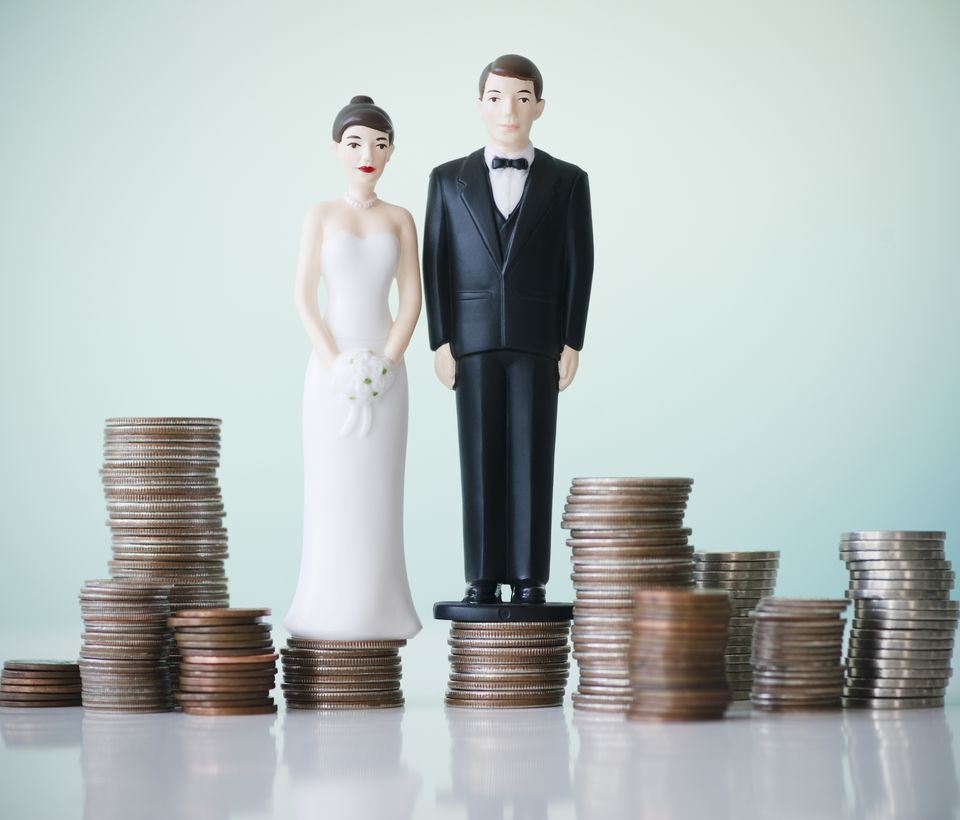 Wedding cake figurines on coin stacks