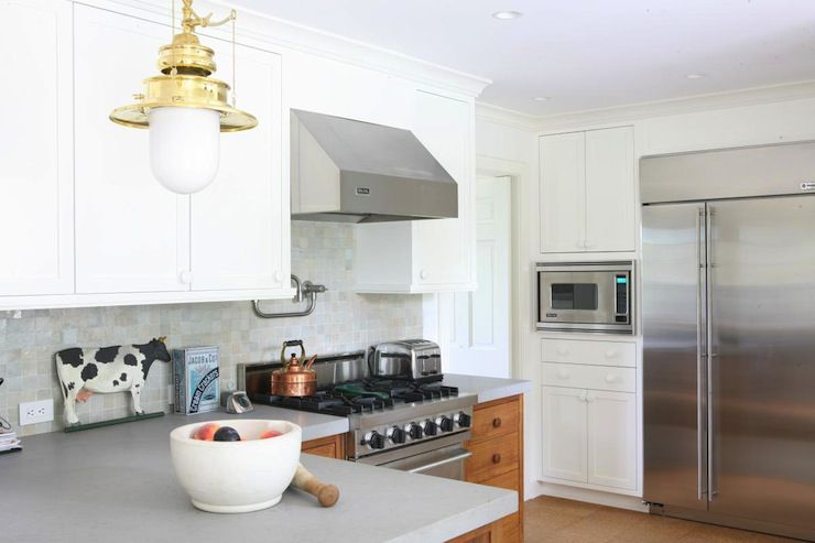 gray corian countertop in traditional kitchen