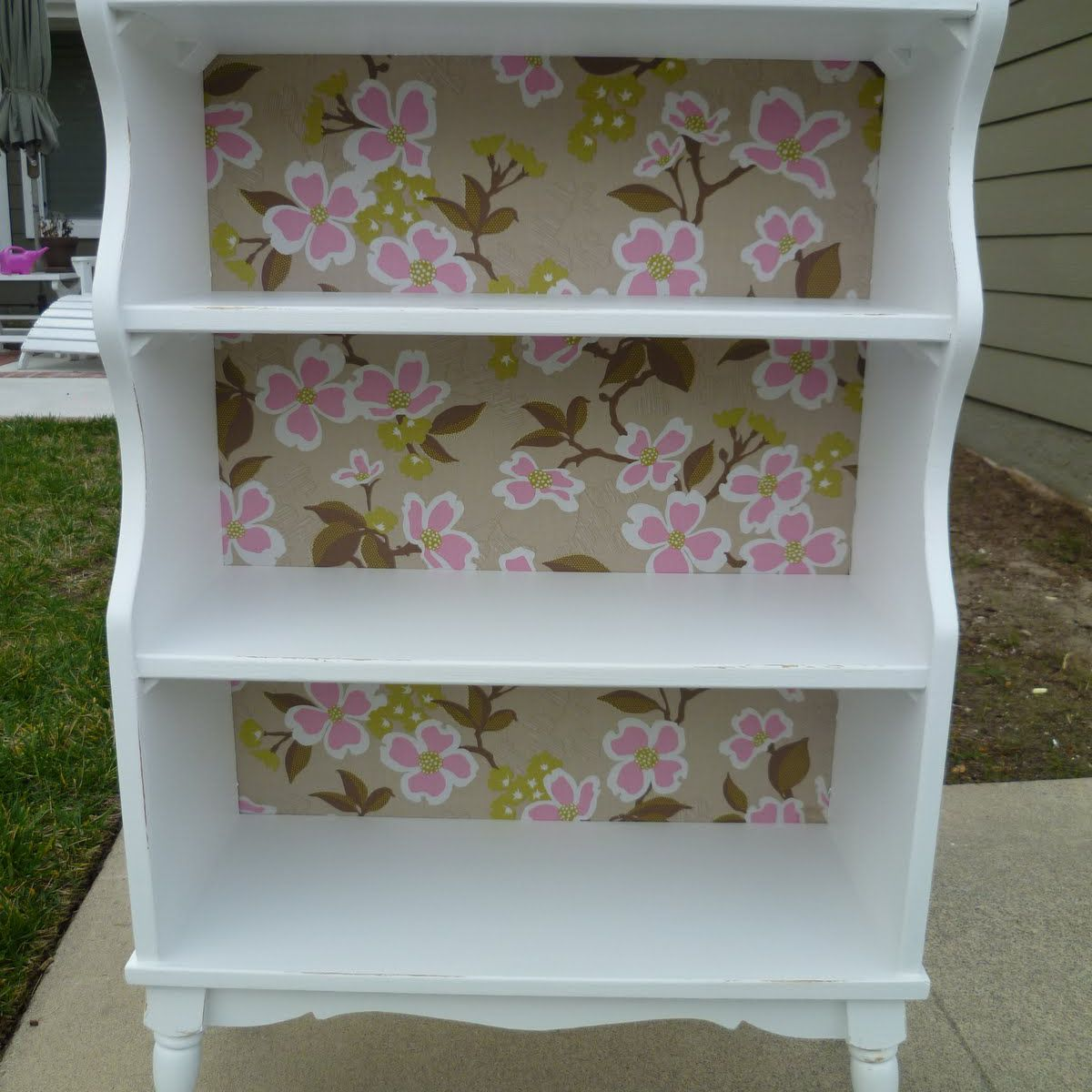White DIY bookcase makeover with a patterned fabric back