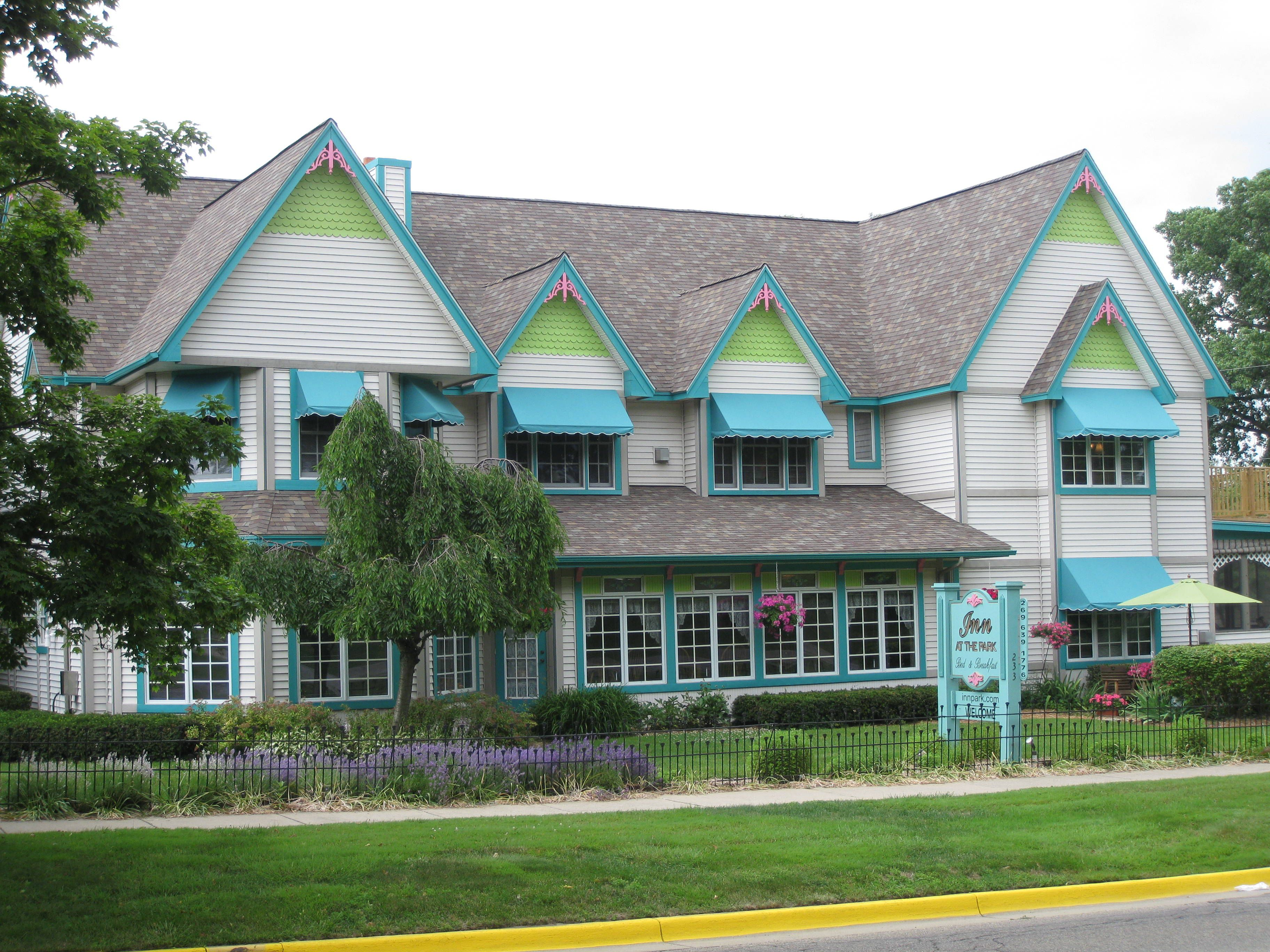 newly constructed multi-gabled dwelling, turquoise awnings, built in the Victorian style