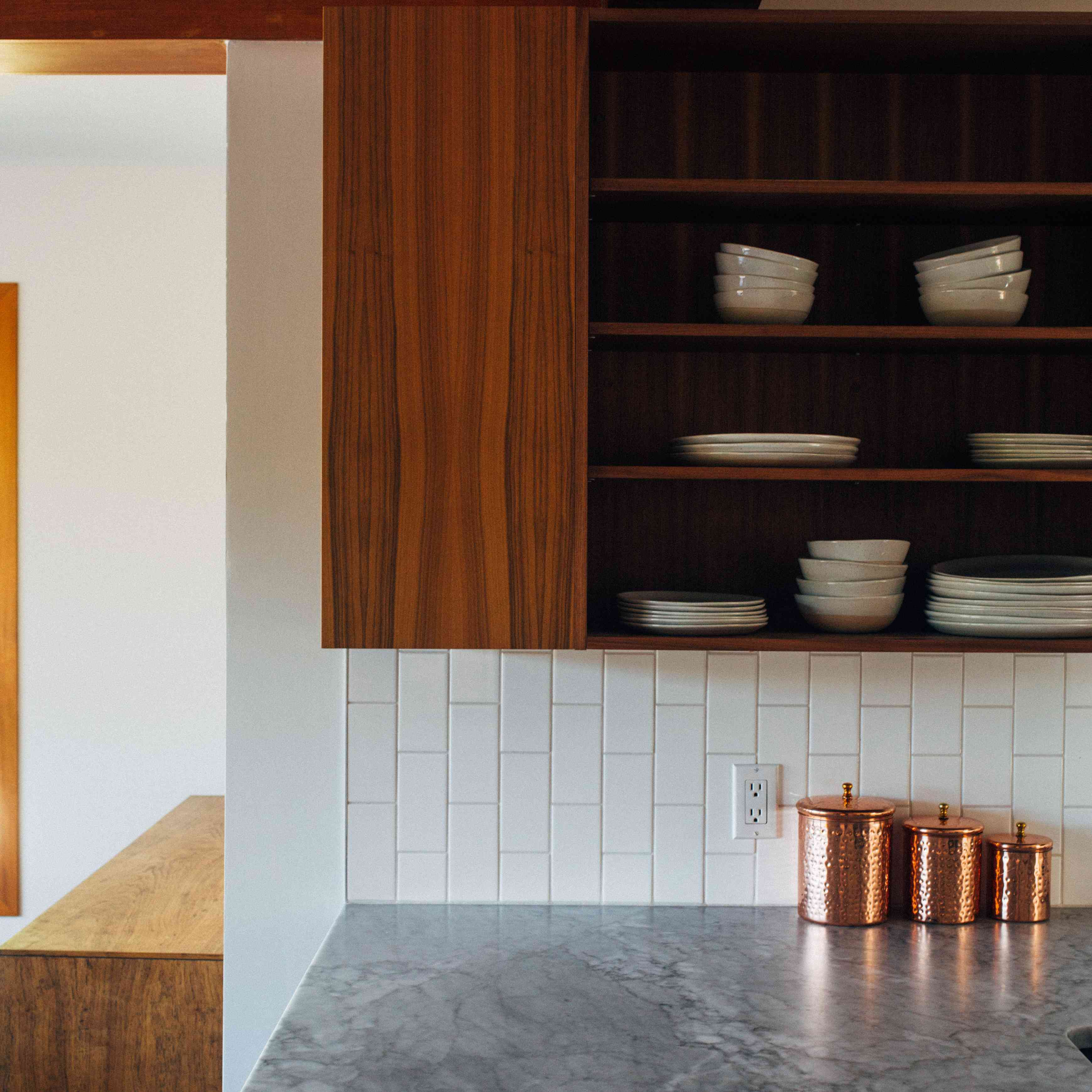 kitchen cabinets with white plates
