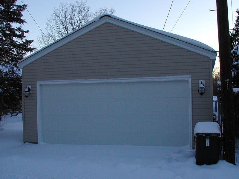 A Two Car Garage Covered In Snow