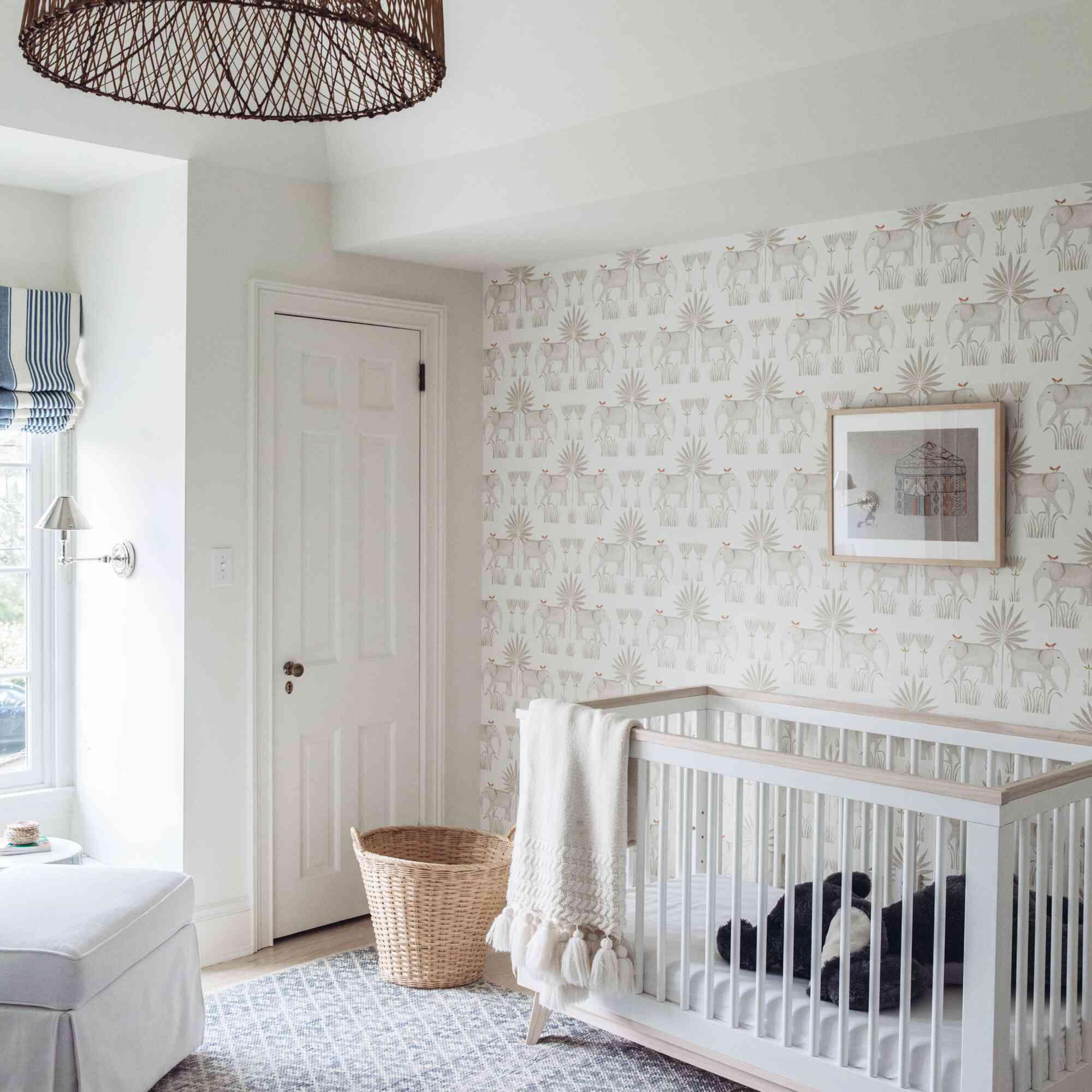 white nursery with elephant wallpaper
