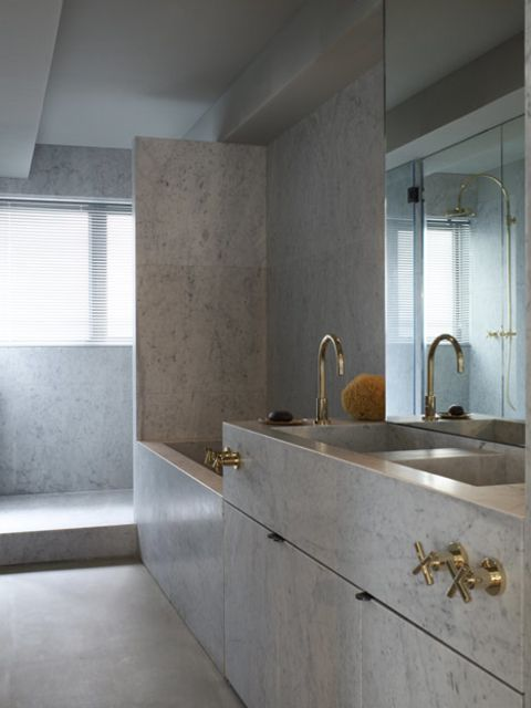 gold and marble in a modern bathroom