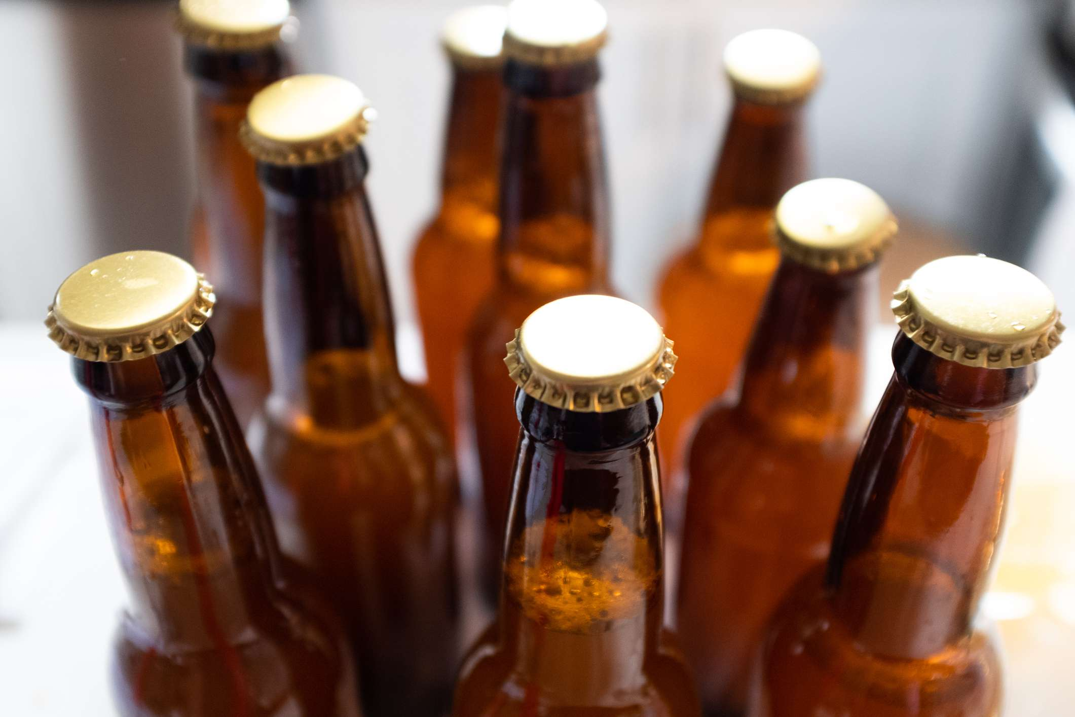Beer bottles with gold caps.